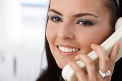 Closeup portrait of pretty girl on phone smiling Stock Image