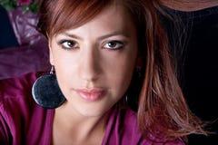 Closeup portrait of a pretty young woman Stock Photos