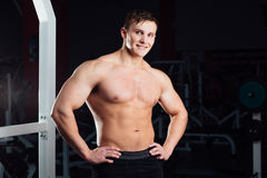Closeup portrait of professional bodybuilder workout with barbell at gym. Confident muscular man training . Looking Royalty Free Stock Image