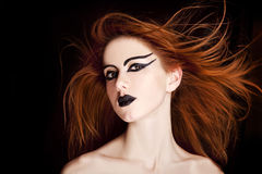 Closeup portrait of a red-haired female Royalty Free Stock Images