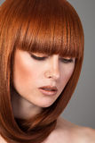 Closeup portrait of red haired woman Royalty Free Stock Photos