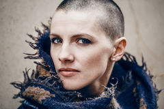 Closeup portrait of sad beautiful Caucasian white young bald girl woman with shaved hair head in leather jacket and scarf Stock Images