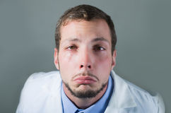 Closeup portrait of sad young doctor crying Royalty Free Stock Photography