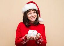 Closeup portrait of Santa girl holding christmas gift. Young hap Stock Images
