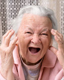 Closeup portrait of scared old woman Royalty Free Stock Photos