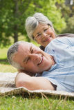 Closeup portrait of a senior couple lying at park Royalty Free Stock Photography
