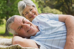 Closeup portrait of a senior couple lying at park Stock Images