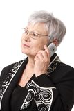 Closeup portrait of senior lady with mobile phone Stock Photography