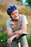 Closeup portrait of a senior man cyclist Stock Images