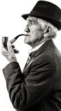 Closeup portrait of a senior smoking a pipe Stock Image