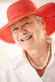 Closeup portrait of senior woman wearing hat royalty free stock image