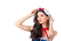 Closeup portrait of a sensual young marine officer. Closeup portrait of a beautiful young sailor woman holding her beret. High resolution image taken in studio Stock Photo