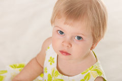 Closeup portrait of a serious toddler Stock Image
