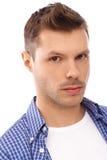 Closeup portrait of serious young man Stock Photos