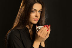 CLoseup portrait of sexy woman enjoying a hot cup of coffee on a Stock Photography