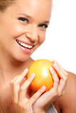 Closeup portrait of a sexy woman with fruit. Blonde woman portrait with grapefruit on white background Stock Photo