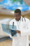 Closeup portrait of shocked african american black doctor, holding folder. Royalty Free Stock Photo