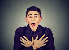 Closeup portrait shocked young man. Shocked young man with wide open mouth Stock Photos