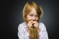 Closeup portrait shy girl isolated grey background Royalty Free Stock Image