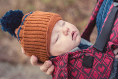 Closeup portrait of sleeping baby in a carrier Royalty Free Stock Photos