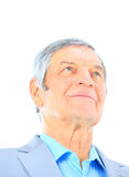 Closeup portrait of a smart senior man smiling on white backgrou Royalty Free Stock Image