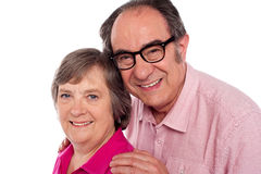 Closeup portrait of smiling aged couple Stock Image