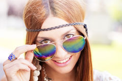 Closeup portrait of smiling beautiful hippie woman looking over Royalty Free Stock Images