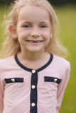 Closeup portrait of smiling blond girl Stock Photo