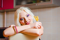 Closeup portrait of smiling blonde girl with candy Stock Image