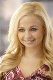 Closeup portrait of smiling blonde woman Stock Photos