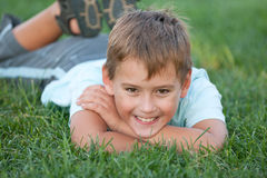 Closeup portrait of a smiling boy on the grass Royalty Free Stock Photo