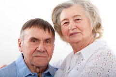 Closeup portrait of smiling elderly couple Stock Image