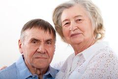 Closeup portrait of smiling elderly couple stock image