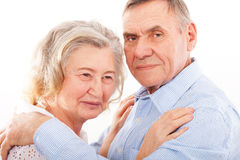 Portrait of smiling elderly couple Stock Photos
