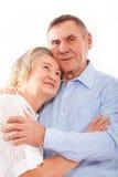 Portrait of smiling elderly couple Stock Images