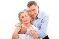 Portrait of smiling elderly couple Stock Photo