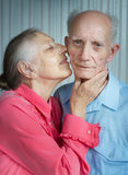 Closeup portrait of smiling elderly couple Stock Photos