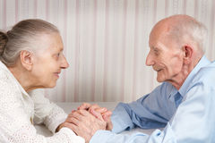 Closeup portrait of smiling elderly couple. Old people holding hands. Concept of marital fidelity, providing for old age, reliability royalty free stock photos