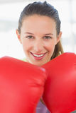 Closeup portrait of a smiling female boxer Stock Photo