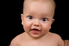 Closeup portrait of smiling infant Stock Images