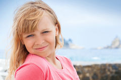 Closeup portrait of smiling little blond girl Royalty Free Stock Images