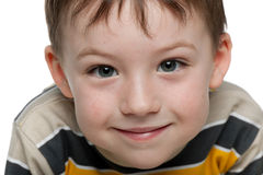Closeup portrait of a smiling little boy Stock Photos