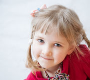 Closeup portrait of a smiling little girl Stock Photos