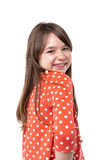 Closeup portrait of a smiling pretty little girl looking over he Royalty Free Stock Photos