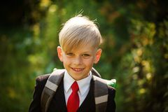Closeup portrait of smiling pupil.Cute boy going back to school. Child with backpack on first school day. royalty free stock image