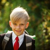 Closeup portrait of smiling pupil. Cute boy going back to school. royalty free stock images