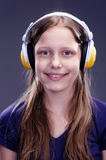 Closeup portrait of a smiling teen girl with headphones Stock Photo