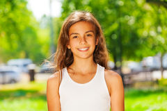Closeup portrait of smiling teenage girl outside Royalty Free Stock Photo