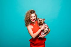 Closeup portrait of smiling young attractive woman looking at camera and embracing Yorkshire terrier. Pet concept. Isolated front royalty free stock photos