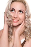 Closeup portrait of smiling young blonde. Isolated Stock Photography